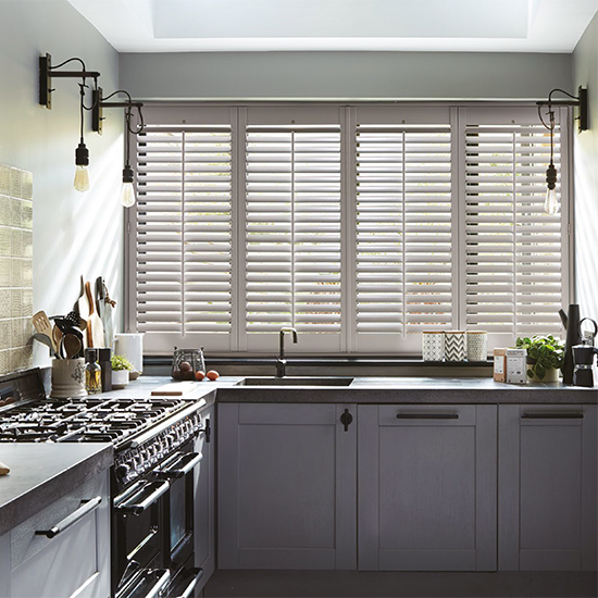 windows in kitchen with shutters